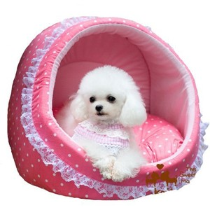 this frilly bed with this adorable pup in it looks as if it was made for a doggie queen